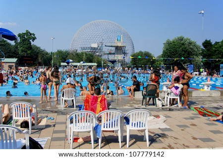 MONTREAL CANADA JULY 15: Parc Jean-Drapeau pool with the biosphere in background on July 15 2012 in Montreal Canada. The pool was the site of the 2006 world FINA aquatic championship in Montreal