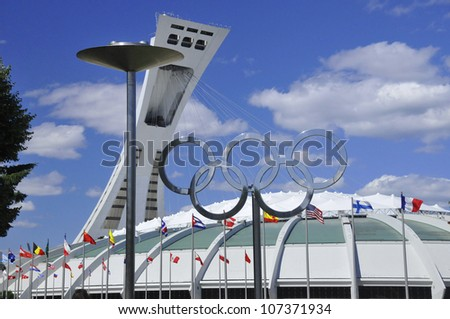 MONTREAL,CANADA -JULY.07.The Montreal Olympic Stadium and tower on July 07 , 2012. It's the tallest inclined tower in the world.Tour Olympique stands 175 meters tall and at a 45-degree angle - stock photo