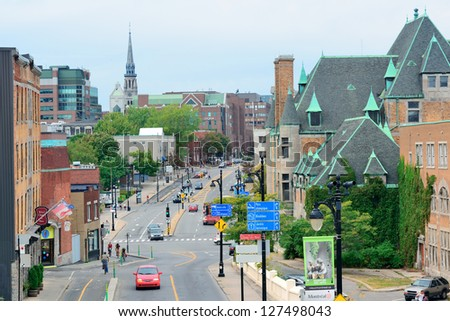 MONTREAL, CANADA - SEP 8: City street view with busy traffic on September 8, 2012 in Montreal, Canada. It is the largest city in Quebec, the second-largest in Canada and the 15th-largest in N America. - stock photo