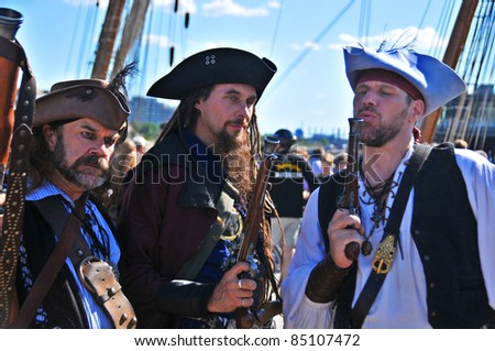 MONTREAL-CANADA SEPTEMBER 18: Men participating as a pirates at Les Grands voiliers sur les Quais 2011Tall Ships on the Quays festival, on September 18, 2011 at Montreal, Canada - stock photo
