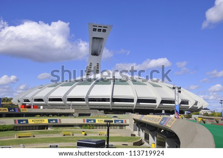 MONTREAL,CANADA -SEPTEMBER 23. The Montreal Olympic Stadium tower on 23, 09, 2012. It's the tallest inclined tower in the world.Tour Olympique stands 175 meters tall and at a 45-degree angle