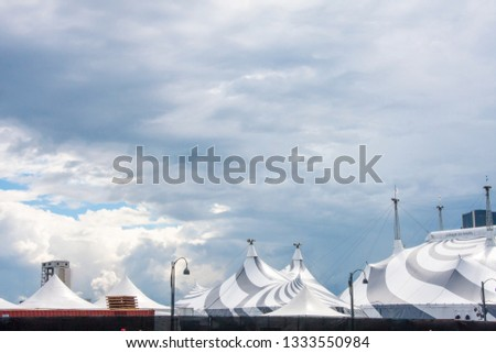 MONTREAL, Canada – 06/20/2019: Top view of circus tents from Le Cirque Du Soleil at the Old Port of Montreal. #1333550984