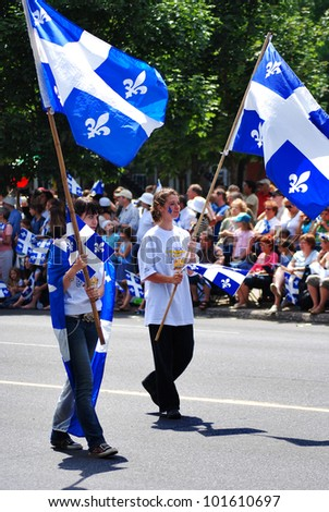 MONTREAL CANADA 06- 24: Unidentified people celebrating Quebec's National Holiday (French: La F�ªte nationale du Qu�©bec) is celebrated annually on June 24, St. John the Baptist Day on 06-24-07 Montreal