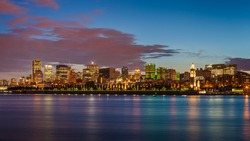 Montreal city skyline over Saint Lawrence River at twilight with urban buildings, Montreal, Quebec, Canada