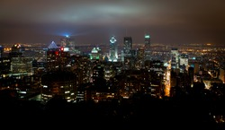 Montreal cityscape at night from top of the hill