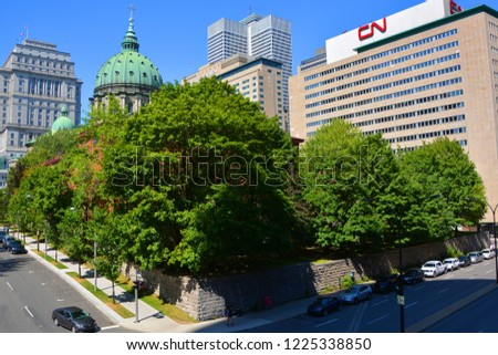 MONTREAL QUEBEC CANADA AUGUST 30 2016: Downtown Montreal Queen Elisabeth Hotel, CN, Sunlife and Place ville Marie Buildings, Cathedral-Basilica of Mary, Queen of the World #1225338850