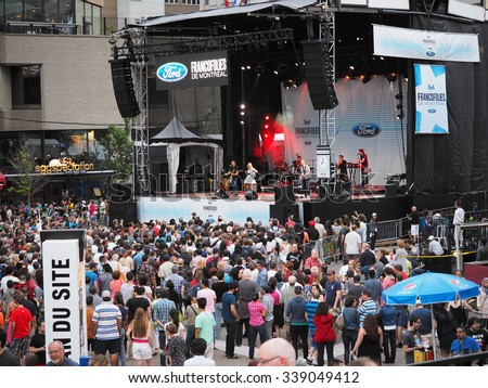 Montreal, Quebec, Canada -  free concert Summer event outdoor entertainment for the family and general public. music, culture, parade, acrobats and lots of fun .