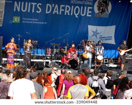 Montreal, Quebec, Canada -  free concert Summer event outdoor nuits d\'afrique african nights stage and audience .