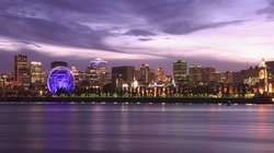 Montreal skyline and St Lawrence River illuminated at dusk, Quebec, Canada