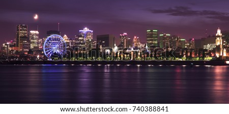 Montreal skyline and St Lawrence River illuminated at night, Quebec, Canada