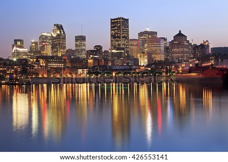 Montreal skyline at dusk and St Lawrence River, Quebec, Canada