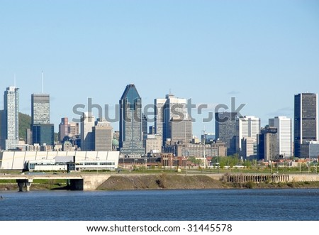 Montreal Skyline from across the St-Lawrence River - stock photo