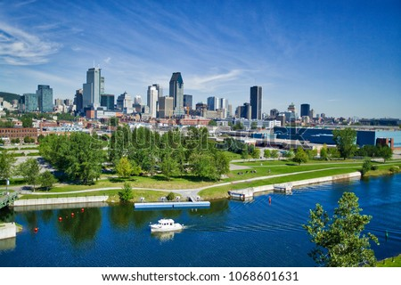 Montreal skyline with yacht in foreground in the Lachine Canal #1068601631