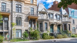 Montreal, typical victorian house with exterior staircase in the Plateau Mont-Royal district in autumn