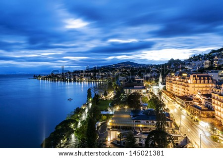 MONTREUX - MAY 19: Night view of Le Montreux Palace Hotel a five star luxury hotel built in 1906 and Montreux Music & Convention Centre (2m2c) and coastline in Montreux in Switzerland on May 19, 2013