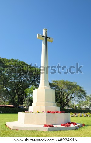 stock-photo-monument-in-cemetery-of-death-railway-in-thailand-48924616.jpg