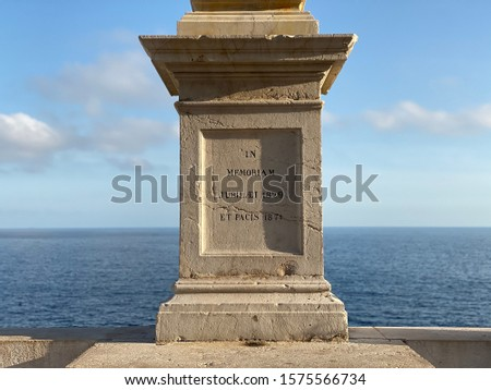Monument in Nice, France with a nice blurred seaview
