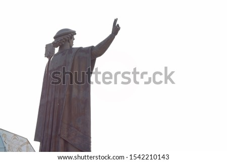 Monument of a man with a raised hand against the sky near the National Library of Belarus. Minsk, Belarus - 26 October 2019, Illustrative Editorial #1542210143