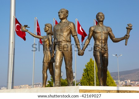Monument of Ataturk and Youth, Kusadasi, Turkey with Turkish flags in the background. The monument signifies peace and hope