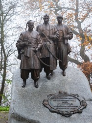 Monument of Ukrainian Cossacks on Leopoldsberg in Vienna (Austria) in winter.  Inscription: Dedicated to the Ukrainian Cossacks - the co-liberators of Vienna in 1683