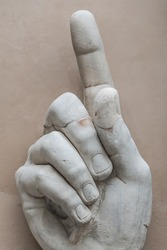 Monument of warning finger pointing up, Rome, Italy, 2014