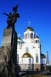 Monument to Komsomol members and church