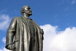 Monument to Lenin, the leader of the russian proletariat against blue sky with white clouds