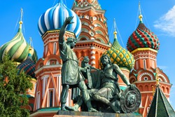Monument to Minin and Pozharsky by St Basil`s Cathedral in Moscow, Russia. Old Saint Basil`s church is landmark of Moscow. Famous architecture in Moscow city center. History and culture concept.