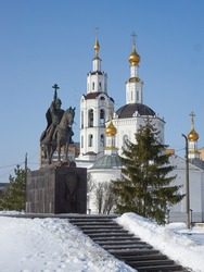 Monument to Russian tsar Ivan Grozny and Epiphany cathedral (Bogoyavlensky sobor) in the city of Oryol, Russia. Translation: 'Tsar Ivan the Terrible, founder of the city of Oryol 1566'