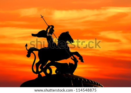 Monument to Saint George and the Dragon on sunset background. The monument is located in the Moscow (Russia). Saint George the Victorious is regarded as one of the most prominent military saints