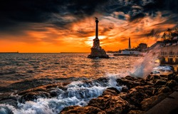 Monument to sunken ships in Black sea water. Sunset Sevastopol city, Crimea, Russia