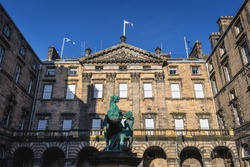 Monument to the Alexander and Bucephalus horse in front of City Chambers building in the Old Town of Edinburgh city, Scotland, UK