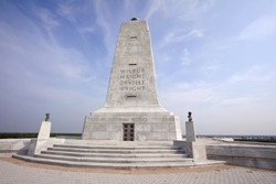 Monument to the first flight of the Wright Brothers in Kitty Hawk, North Carolina against a dramatic sky