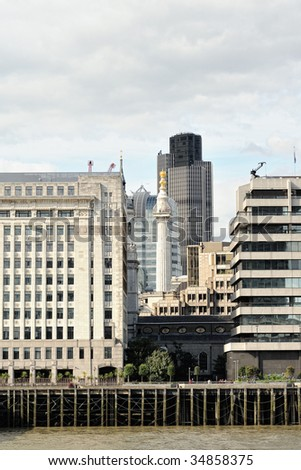 Monument to the Great Fire of London, England, UK, Europe, enclosed by modern office buildings, with Tower 42 in the background, looking over the River Thames