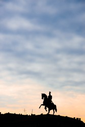 Monument to Tsar Nicholas I in St. Petersburg on St. Isaac's Square. Silhouette at sunrise