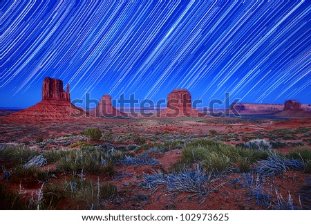 Monument Valley Arizona USA Star Trail Landscape Image. Image Has Slight Grain Due to Conditions.