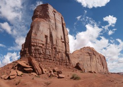 Monument Valley famous Cly Butte rock formation, sunny day, blue sky