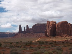 Monument Valley famous Three Sisters mesa, Cly Butte and Mitchell mesa,  Loop road, nice clouds above