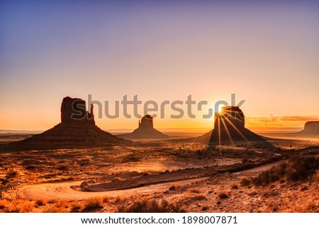 Monument Valley in Navajo National Park at Sunrise, Border of Utah and Arizona, USA