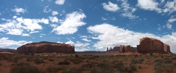 Monument Valley Panorama, Three Sisters, Cly Butte, Elephant Butte and Rain God Mesa, nice clouds above