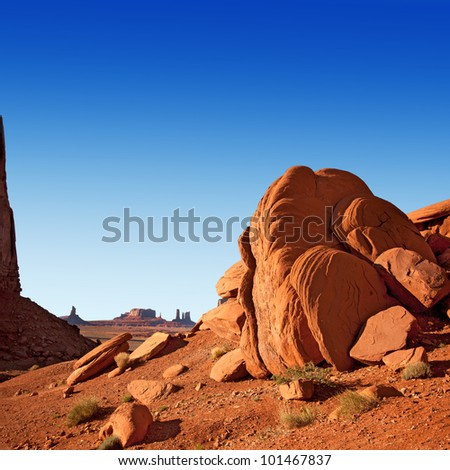 stock-photo-monument-valley-utah-usa-showing-typical-rock-formations-the-sandstone-is-a-very-red-colour-due-101467837.jpg