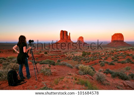 monument valley with nice sunset, being photographed, focus on rocks