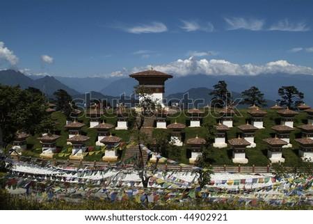 monument with 108 chorten on the dochu la pass - druk wangyal - and himalaya range in background