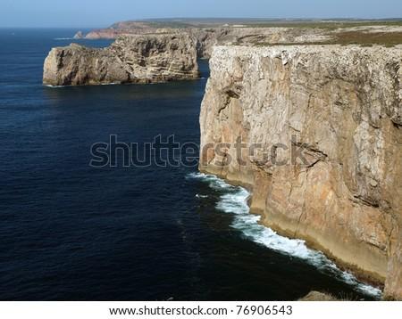 Monumental cliff coast near Cape St  Vincent, Portugal - stock photo