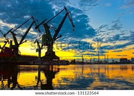 Monumental Cranes at sunset in Shipyard.