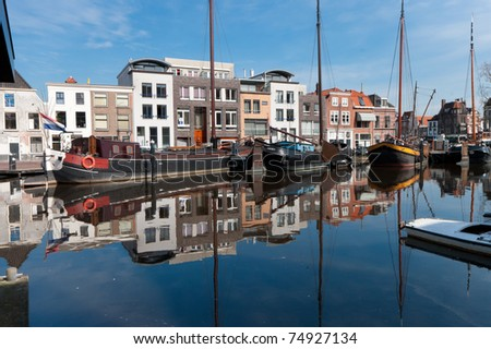 monumental houses reflected in a canal in Leiden, Netherlands