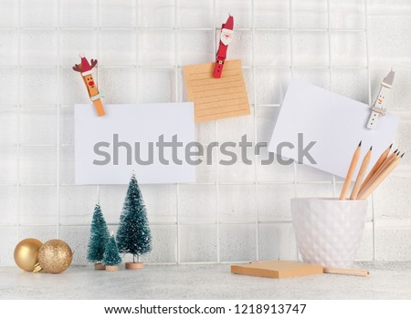 Mood board with empty cards on it near Christmas trees and balls.