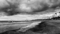 Moody black and white oregon coastline on cloudy day