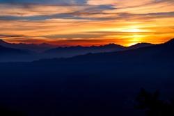 Moody, distant sunset -- Himalayas, India
