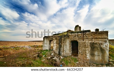 Moody landscape of a ruined building and sky with clouds